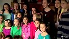 Newtown Shooting Survivors Sing Somewhere Over t...
